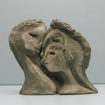 Family -2 sided.Made of Terracotta .Bronze cast is optional..8.5 H by 9 W by 3  inch D