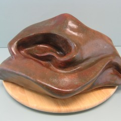 Sensual.Made of  Mixed powder clay and cement. 8 H by 17.5 inch Long,by 12 W