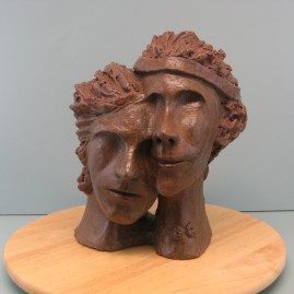 Enmashed couple. Made of Terracotta.11.5 H by 28  inch perimeter