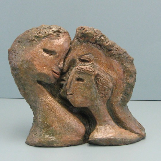 Family -2 sided.Made of  Hydrocal .Bronze cast is optional..8.5 H by 9 W by 3  inch D