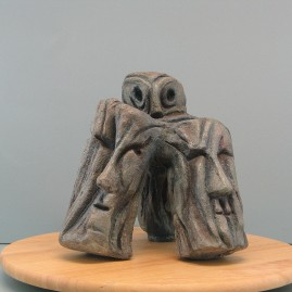 Wisdom of old age.Made of clay.  9.5 H by 11 W by 9 W  inch.(30 in perimeter)Bronze is optional