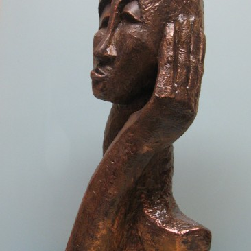Skeptical.Made of a mix of powder clay and cement. 21.5 H by 25 inch perimeter