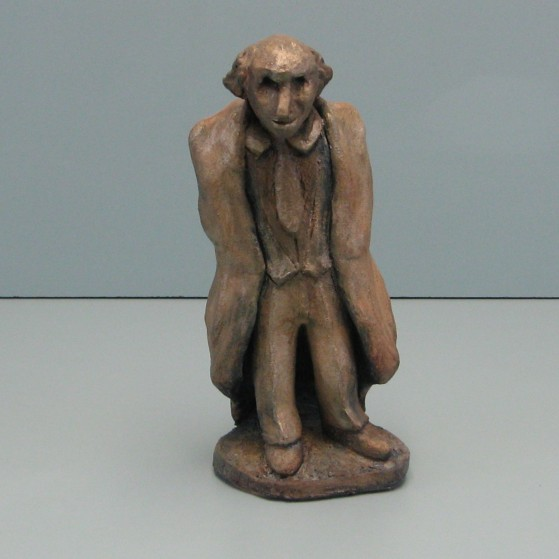 Scrutinize. Old times Judge. Made of clay.9 H by 12 inch perimeter