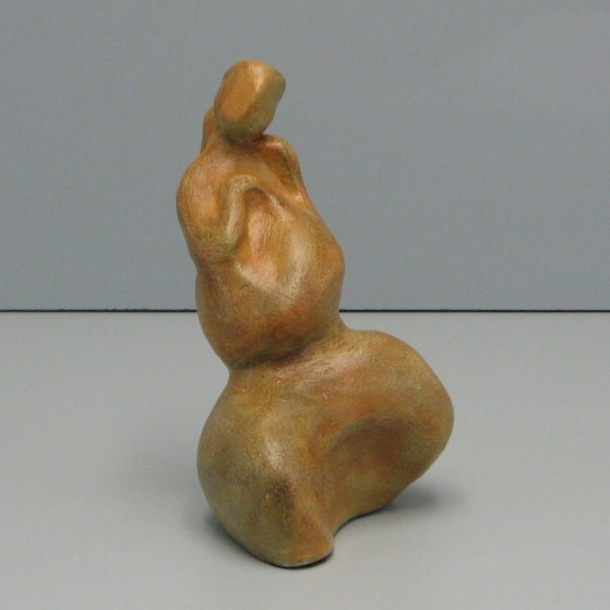 Shy.Made of clay. 6.5 H by 11 inch perimeter
