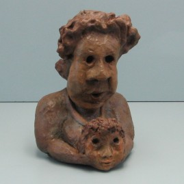 Anxious about her grandson.Made of clay. 9 H by 19.5 inch perimeter