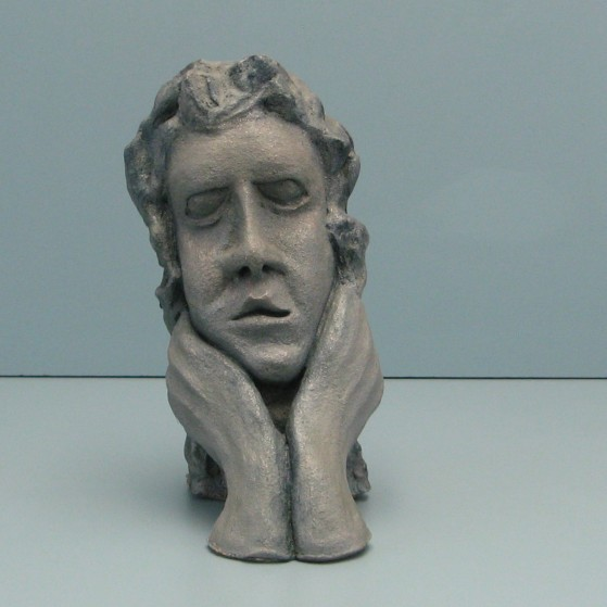 Worried.Made of clay. 9.5 H by 18.5 inch perimeter
