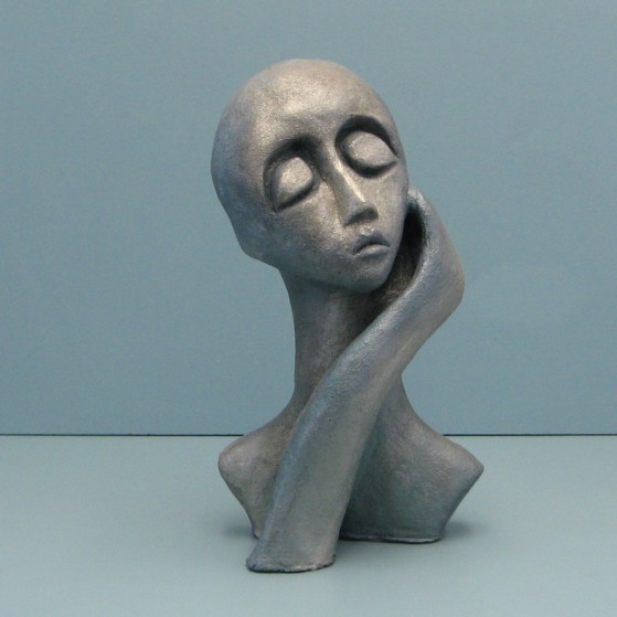 Full of herself.Made of  clay.There is an option to make a bronze cast. 13 H by 18 inch perimeter