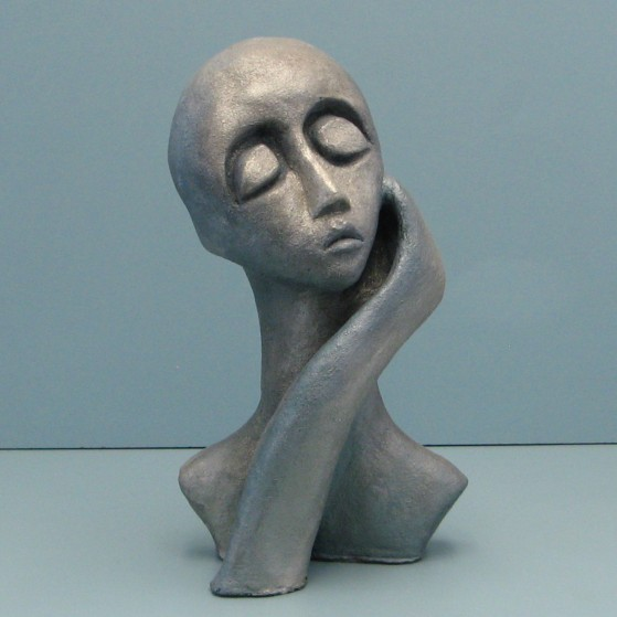 Full of herself.Made of clay.There is an option to cast in Bronze.13 H by 18 inch perimeter