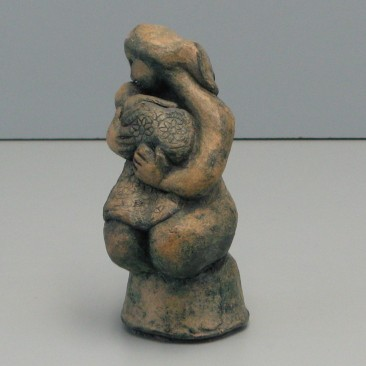Motherhood.Made of clay.6 H by 8 inch perimeter.