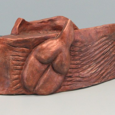 2 sided female .Made of  Terracotta. 3.5 H by 9.5 L by 3.5 inch W