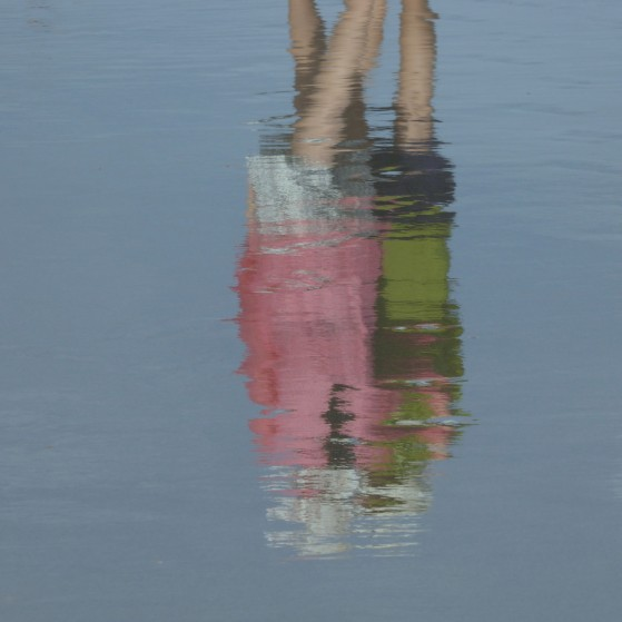 Bahamas,Reflections of girls on the wet sand of the beach no.3