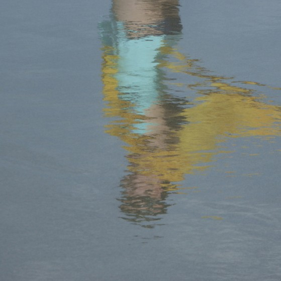 Bahamas,Reflections of girls on the wet sand of the beach no.5